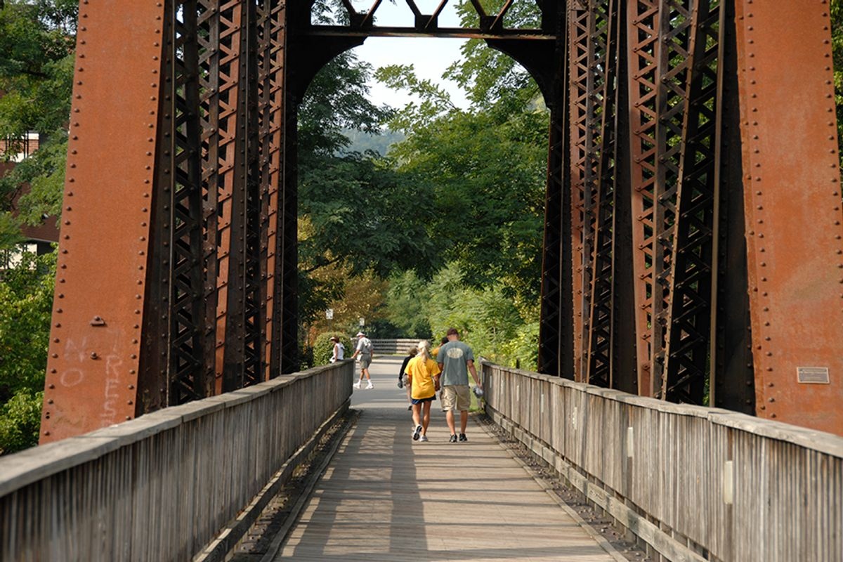 Two people walking on bridge